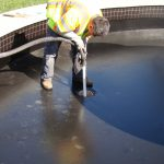 Khoi_CleaningDirtyWaterFromFilterSump_4Mar2015_r_s_5248
